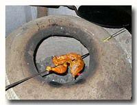 タンドーリチキンを焼いているところ
